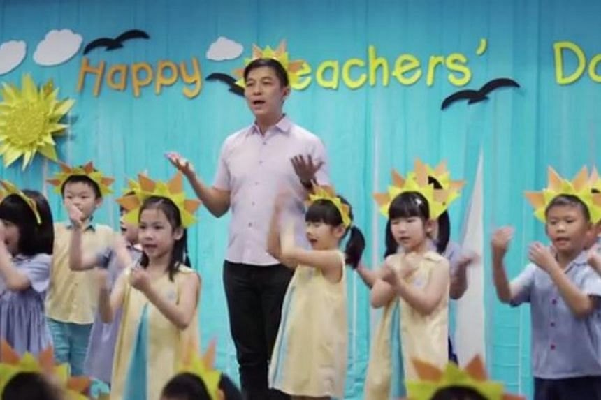 Minister for Social and Family Development Tan Chuan-Jin sings You Are My Sunshine with a group of children.