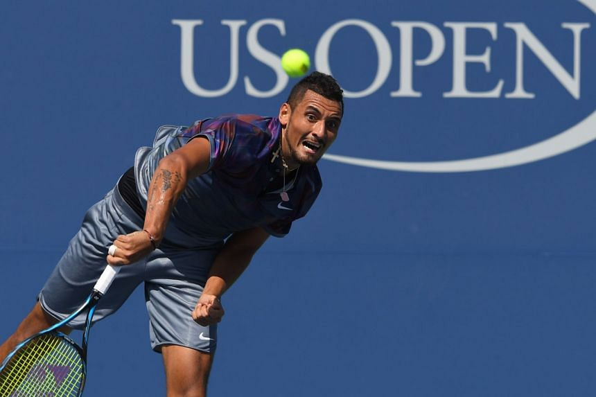 Kyrgios returns the ball to Australia's John Millman.
