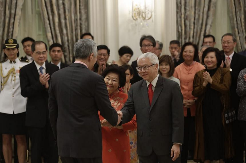 (From left) PM Lee Hsien Loong (back to camera), Mrs Mary Tan and President Tony Tan at the farewell ceremony at the Istana, on Aug 31, 2017.