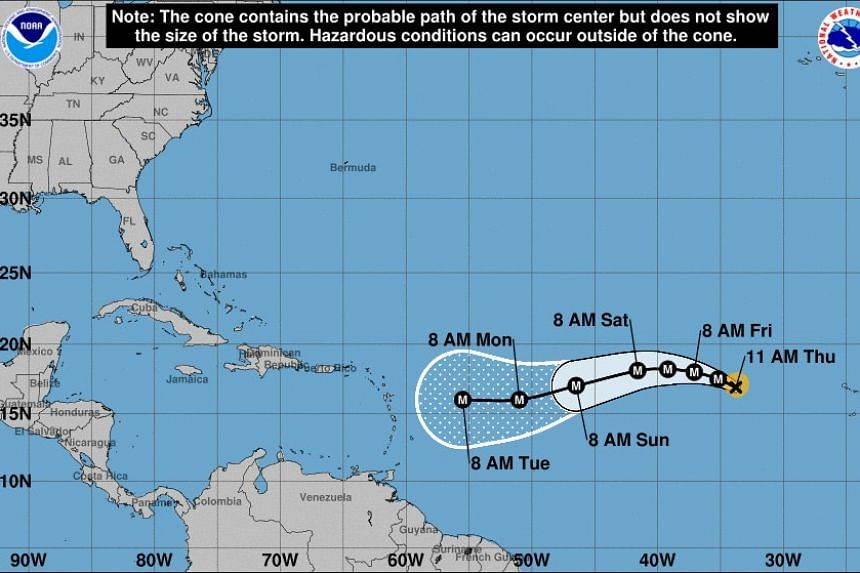 A handout graphic shows a five-day forecast of the possible development and path of hurricane Irma.