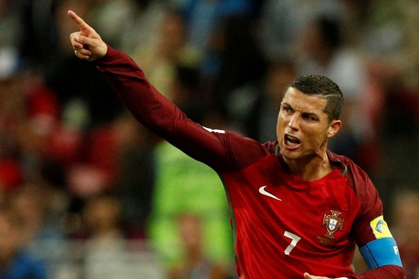 Ronaldo (above, in a file photo) is Portugal's record scorer.