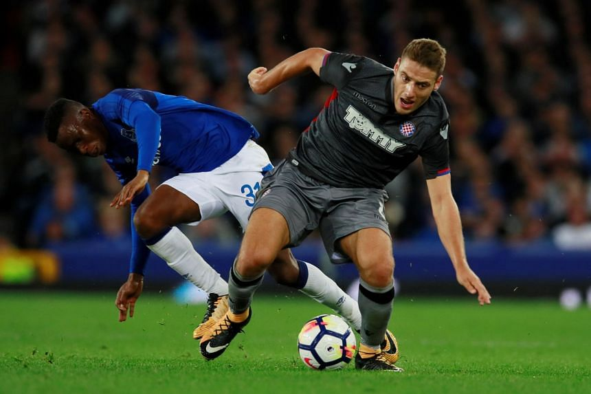 Nikola Vlasic in action with Everton's Ademola Lookman.