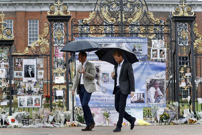 Princes William and Harry (far right) paid a quiet tribute to their mother, Princess Diana, on Wednesday, a day before the 20th anniversary of her death. Along with Prince William's wife, Kate, they toured a memorial garden at Princess Diana's former