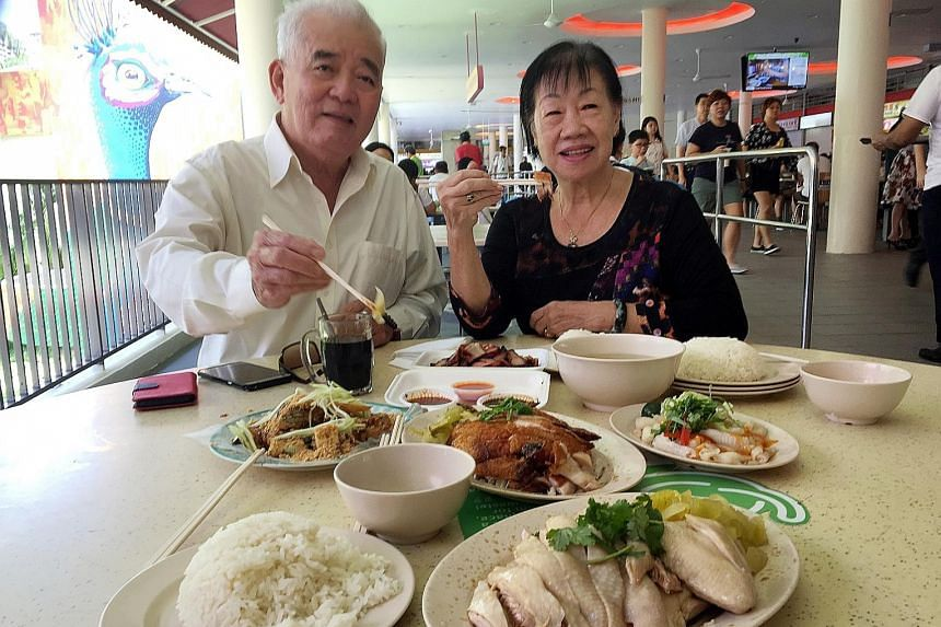 Mr Mah Yap Hong, 76, and his wife, Madam Seow Hee Kiow, 75, a table cleaner, at Tiong Bahru Market and Food Centre. They were indulging because they were eating with relatives. They say their usual diet is healthier.
