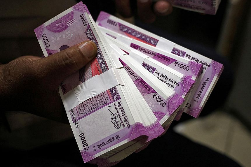 New 2,000-rupee banknotes. India's demonetisation move last year had prompted the central bank to print new currency notes, reducing the profit and cutting annual dividend payout to the government by half.