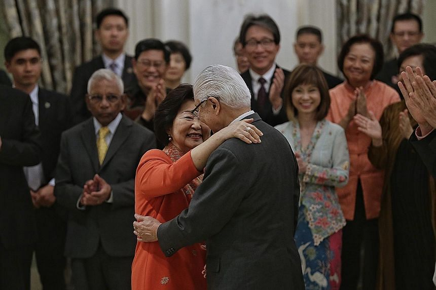 Dr Tony Tan Keng Yam getting a hug from his wife Mary as he stepped down as president at the Istana yesterday. In his speech, PM Lee noted how Mrs Tan was always by her husband's side and would put everyone at ease, while Dr Tan said she brought warm