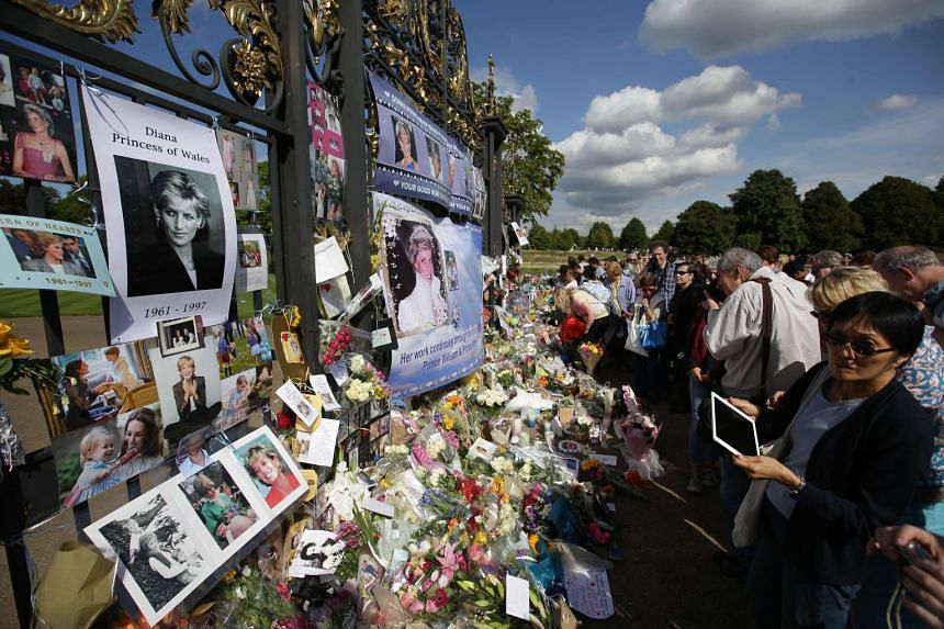 Tributes to Diana outside one of the gates of Kensington Palace in London, Aug 31, 2017.