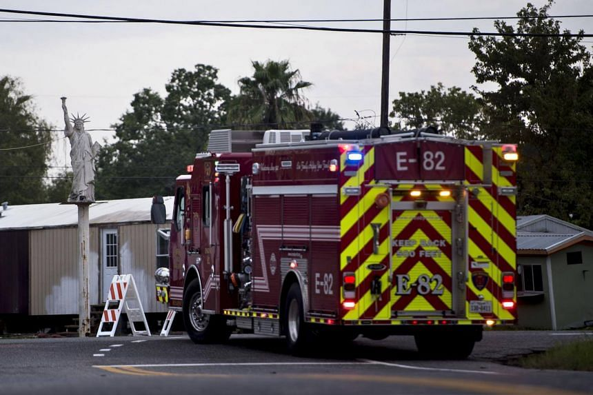 A firetruck waits at a roadblock after a chemical plant operated by the Arkema Group had an explosion during the aftermath of Hurricane Harvey on Aug 31, 2017.
