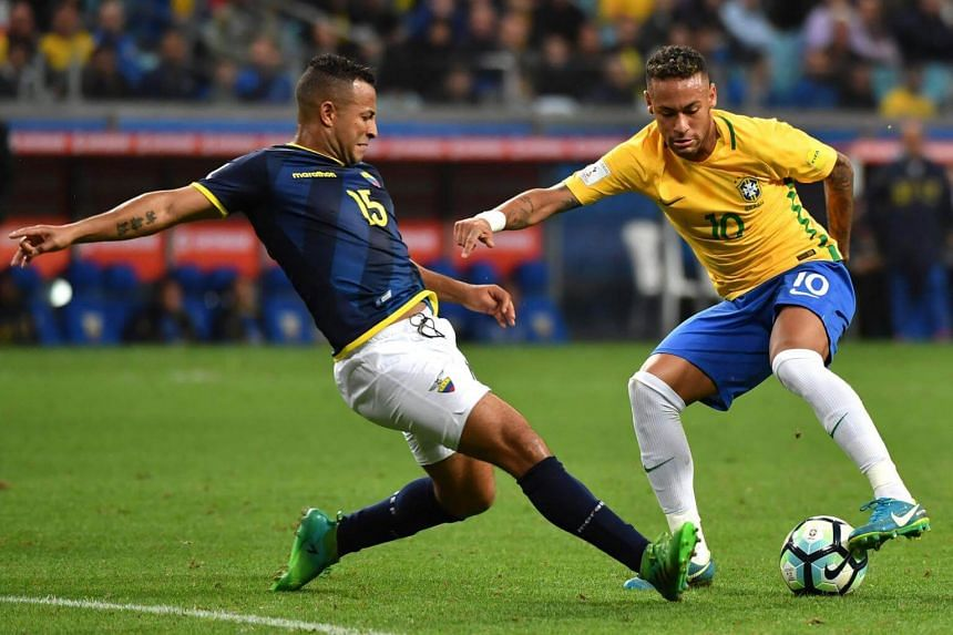 Brazil's Neymar (right) is marked by Ecuador's Pedro Quinonez during their 2018 World Cup qualifier football match in Porto Alegre, Brazil, on Aug 31, 2017.