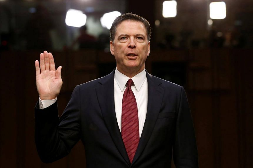 Former FBI Director James Comey is sworn in prior to testifying before a Senate Intelligence Committee hearing on Russia's alleged interference in the 2016 US presidential election on Capitol Hill in Washington, US on June 8, 2017.