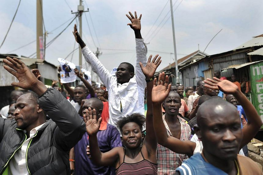 Supporters of Kenya's opposition National Super Alliance (NASA) celebrate in the streets of the Nairobi slum Mathare on Sep 1, 2017.