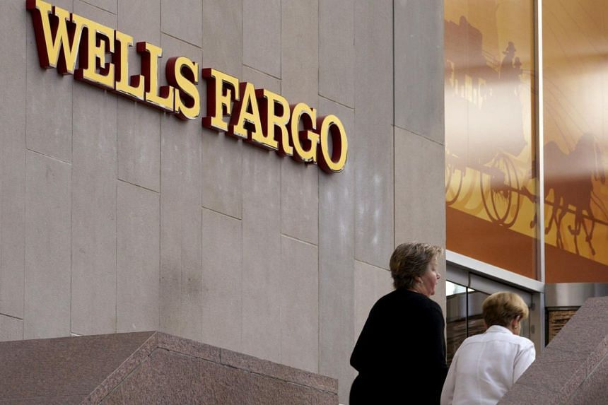Customers approach the Wells Fargo & Co. bank in downtown Denver, US on April 13, 2016.
