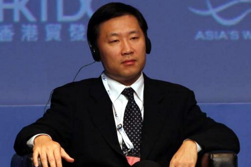 Former vice-chairman of China's securities regulator, Mr Yao Gang, takes part in the Asian Financial Forum in Hong Kong on Jan 16, 2012.