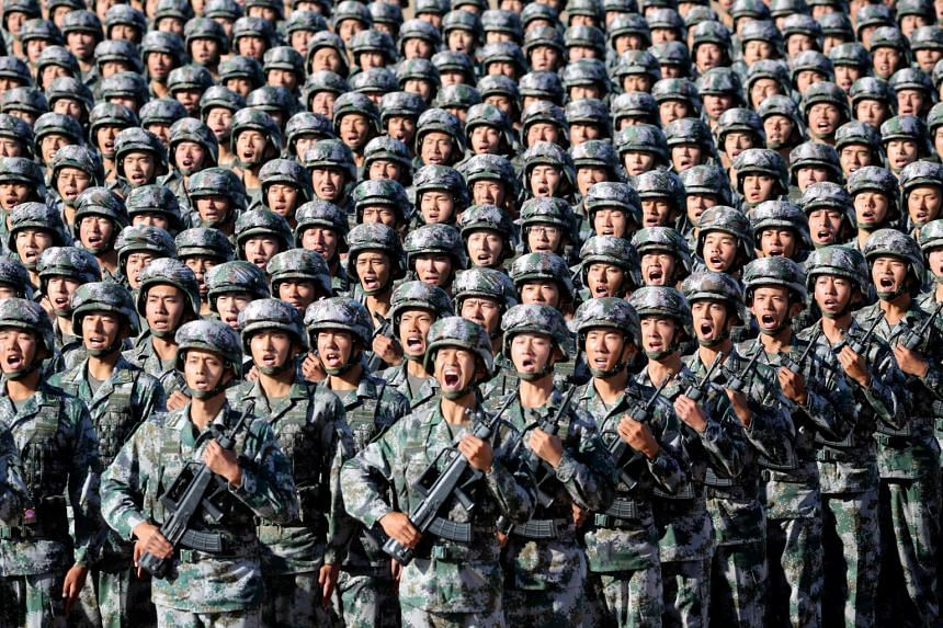 Soldiers of China's People's Liberation Army get ready for a military parade at Zhurihe military training base in Inner Mongolia Autonomous Region, on July 30, 2017.