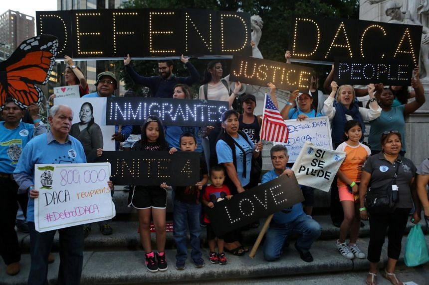 People protest against US President Donald Trump's proposed end of the DACA program on Aug 30, 2017.