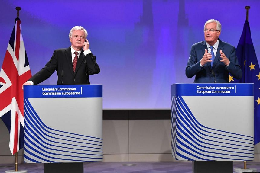 British Secretary of State for Exiting the European Union (Brexit Minister) David Davis (left) and EU chief Brexit negotiator Michel Barnier at the European Union Commission Headquarters in Brussels on Aug 31, 2017.