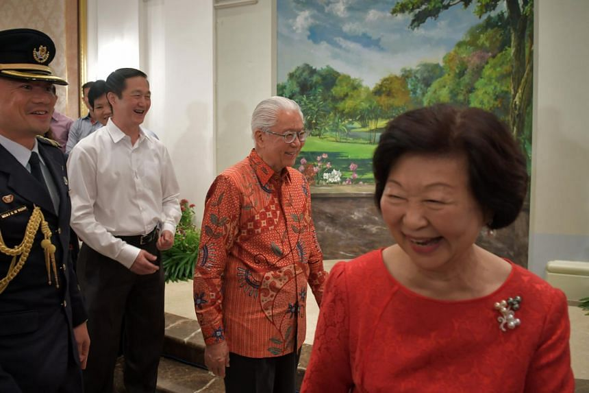 President Tony Tan Keng Yam teases Mrs Mary Tan that it is now his turn to take a picture with his past and present Personnel Security Officers after Mrs Tan had taken one with her past and present female Personnel Security Officers, on Aug 23, 2017.