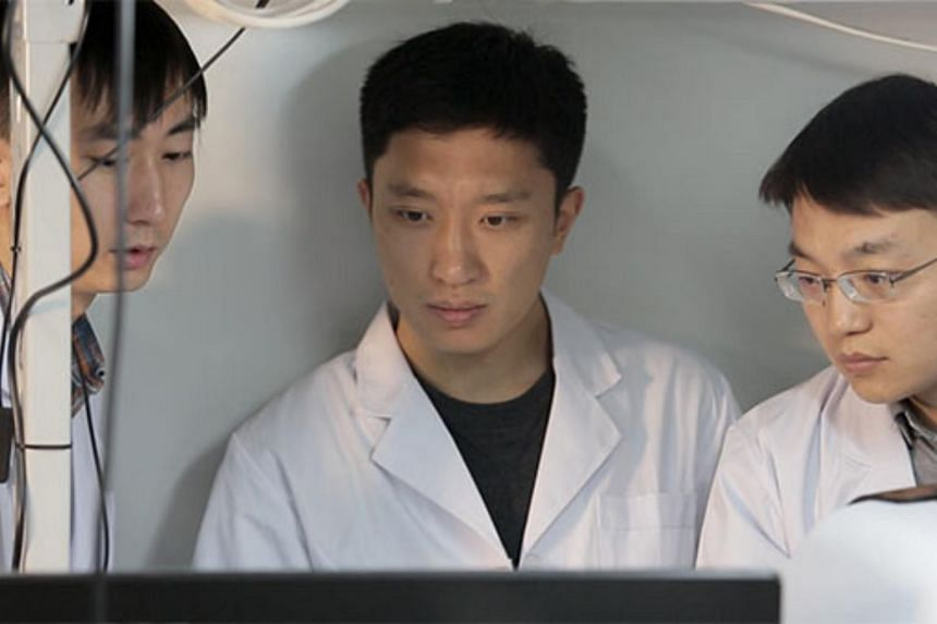 A spectrometer developed by Tsinghua University professor Bao Jie  (centre) can diagnose skin disease and detect air pollution, among other functions.
