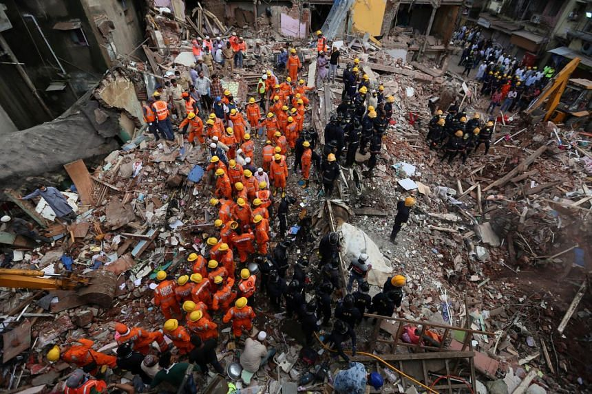 Rescuers in India's financial capital sifted through rubble on Friday (Sept 1) in a desperate search for survivors of the collapse of a 117-year-old condemned building, as the toll from the disaster rose to 33.