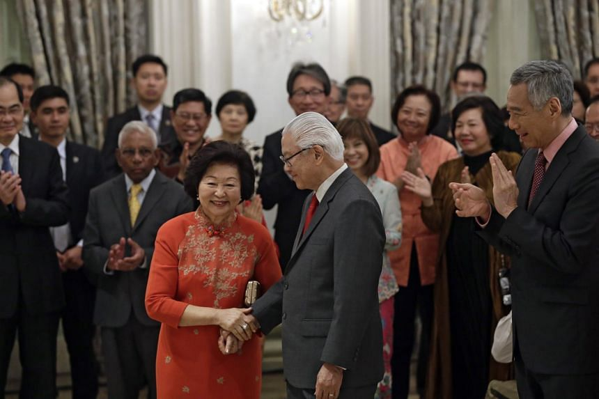 President Tony Tan Keng Yam holding the hand of his wife Mrs Mary Tan after acknowledging her support in his speech at the farewell reception and ceremony at the Istana on Aug 31, 2017.