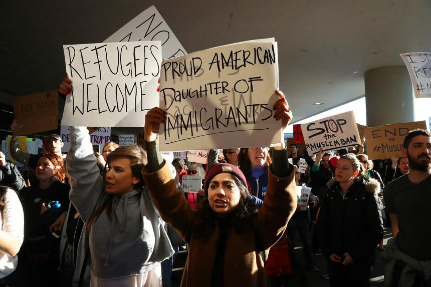 Protesters gather to denounce President Donald Trump's ban on the entry of refugees and people from seven predominantly Muslim countries at San Francisco International Airport, on Jan 28, 2017.