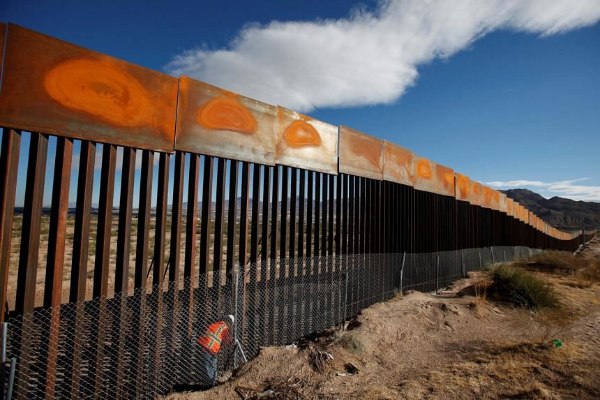 A US worker inspects a section of the US-Mexico border wall at Sunland Park, US, opposite the Mexican border city of Ciudad Juarez, Mexico, on Nov 9, 2016.