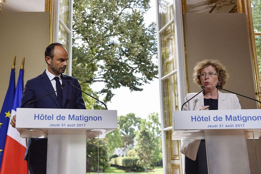 France's PM Edouard Philippe and Labour Minister Muriel Penicaud at the press conference in Paris yesterday, where they set out the government's labour reform plans. Mr Philippe said the current labour code is seen by foreign investors and bosses