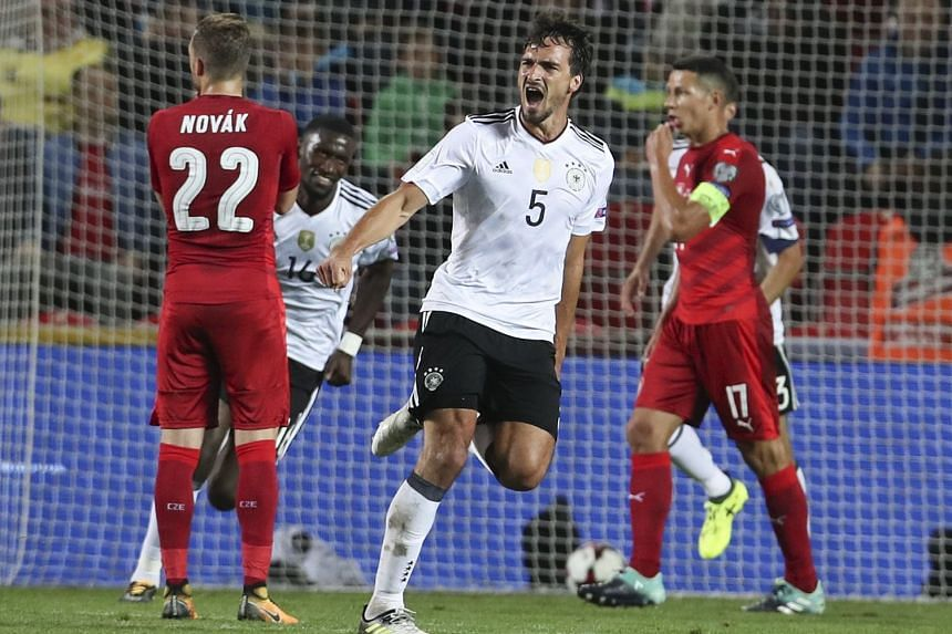 Germany's Mats Hummels (centre) celebrates scoring the 2-1 lead.