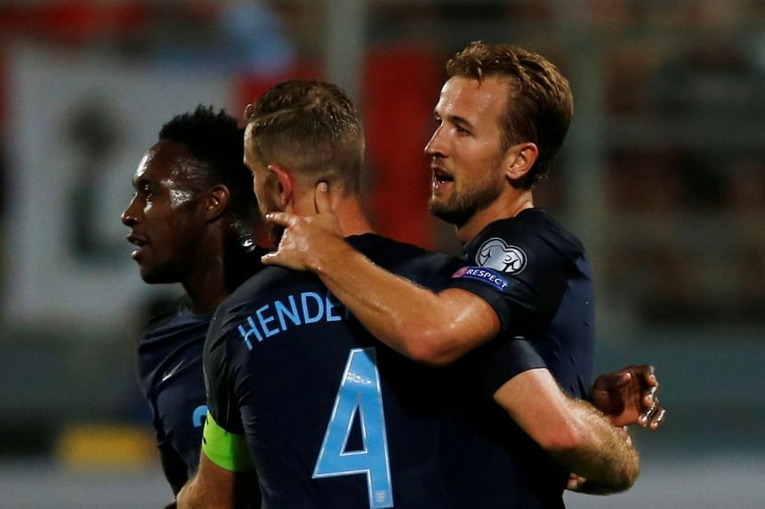 England's Harry Kane, Jordan Henderson (centre) and Danny Welbeck (left) celebrate a goal.