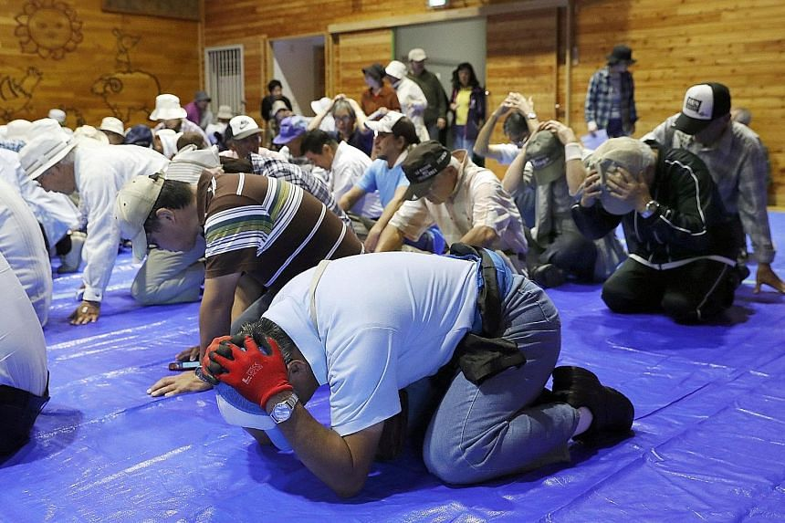 Residents in Takikawa town, located on Japan's northern-most main island of Hokkaido, taking part in an emergency drill yesterday. Japan, one of the world's most earthquake-prone countries, carries out disaster drills every year on Sept 1. This year,