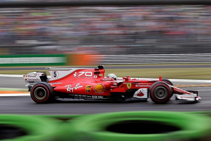 Sebastian Vettel during yesterday's first practice session for the Italian Grand Prix. His car carried special livery commemorating Ferrari's 70th anniversary in Formula One, but the Italian team opted not to switch to their fourth engine of the seas
