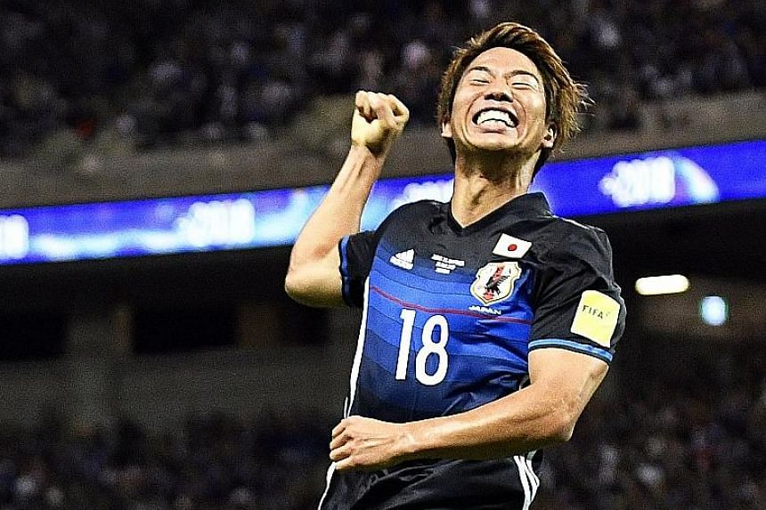 Forward Takuma Asano after giving Japan the lead against Australia. Yosuke Ideguchi added a second to confirm their position as group winners. Coach Vahid Halilhodzic is determined they go to Finals as challengers, not tourists.