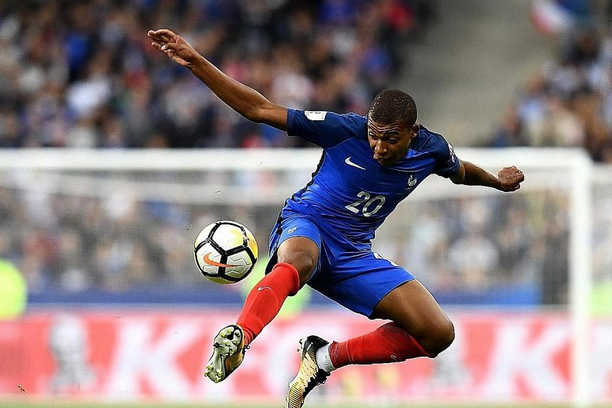 France striker Kylian Mbappe notches his first international goal for France in their World Cup qualifier against the Netherlands.