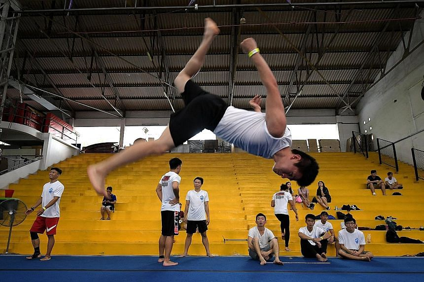 Martial arts instructor Teo Chee Wei, 22, performing a flashkick during the Singapore Tricking Gathering yesterday at the GymKraft gymnasium in Guillemard Road. It was the first such formal gathering here for practitioners of the discipline, which is