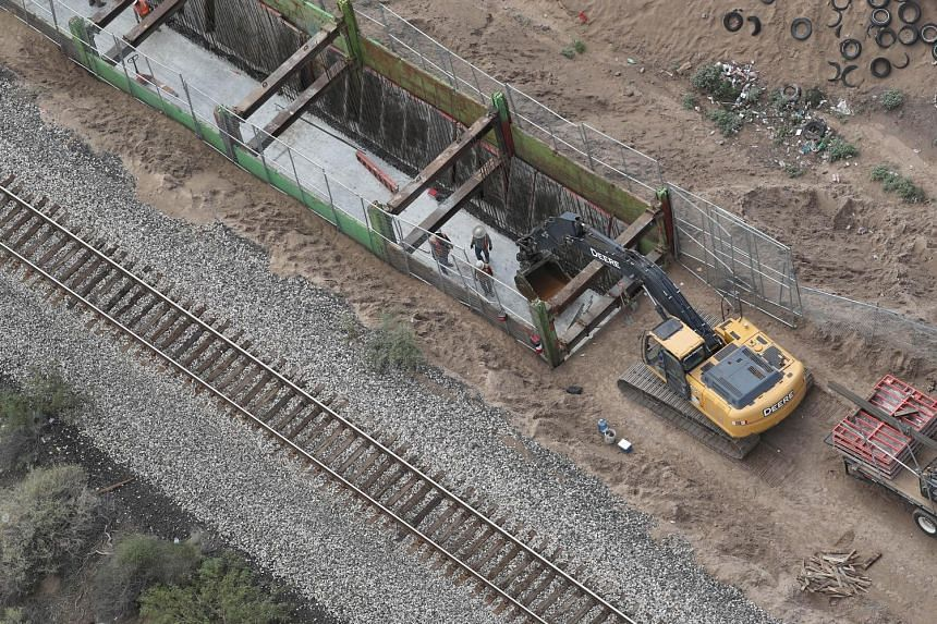Work being done on a new section of the US-Mexico border fence on Aug 1.