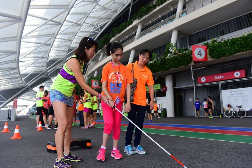 Special Olympics Singapore athletes enjoying the activities laid out for them.