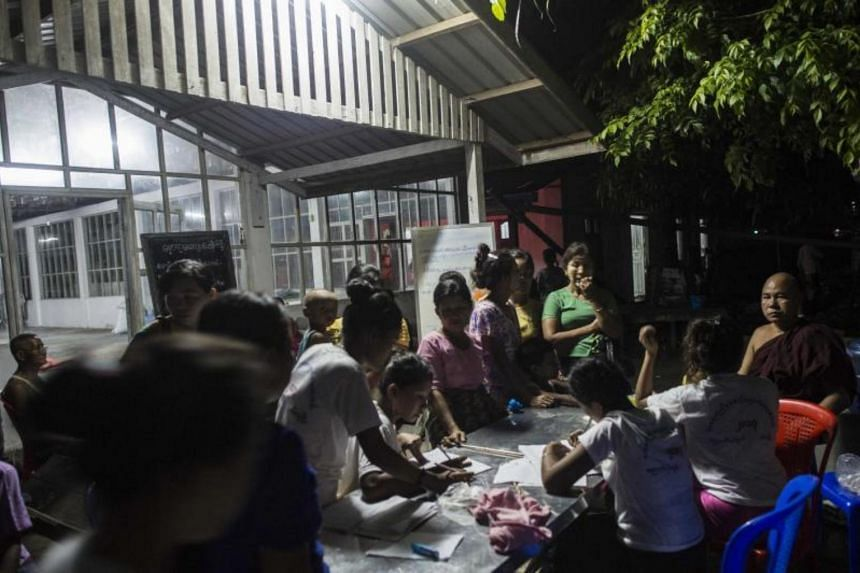 This photo taken on Aug 30, 2017 shows people displaced from communal violence registering at a temporary shelter in Sittwe, Rakhine State.