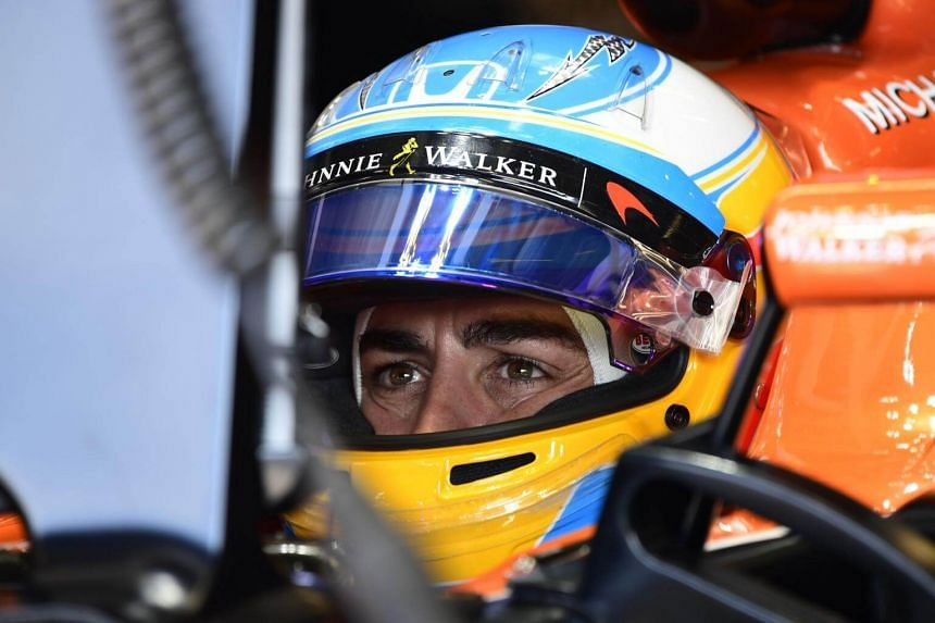 McLaren's Spanish driver Fernando Alonso sits in his car in the pits during the second practice session at the Autodromo Nazionale circuit in Monza on Sep 1, 2017.