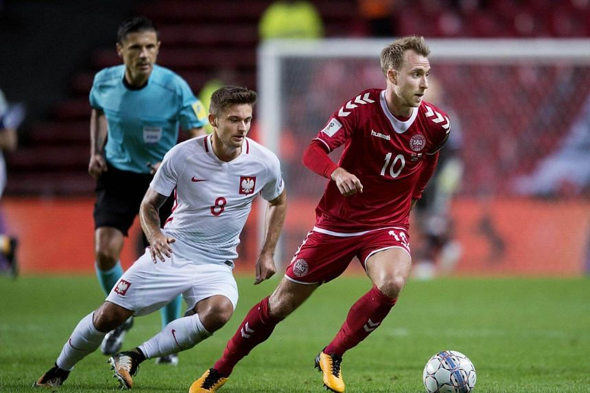 Denmark's Christian Eriksen and Karol Linetty of Poland vie for the ball during the FIFA World Cup 2018 qualification football match between Denmark and Poland in Copenhagen on Sep 1, 2017.