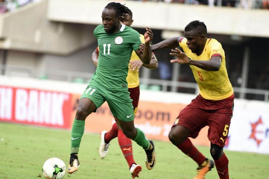 Nigeria's attacker Victor Moses (left) vies with Cameroon's players during the 2018 FIFA World Cup qualifying football match between Nigeria and Cameroon at Godswill Akpabio International Stadium in Uyo, southern Nigeria, on Sep 1, 2017.
