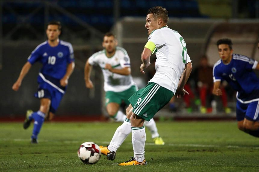Northern Ireland's midfielder Steven Davis scores a penalty during the 2018 FIFA World Cup qualifying football match San Marino vs Northern Ireland at the San Marino Stadium, in Serravalle, on Sep 1, 2017.