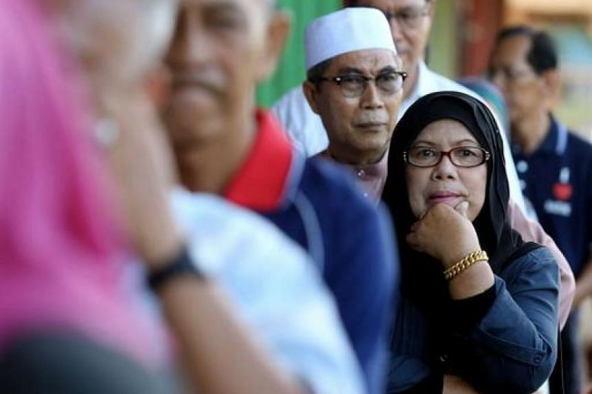 A Malaysian woman waiting in the queue to cast her vote at a polling station in Kuching, on May 7, 2016.