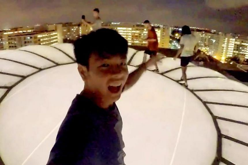 Some of the stunts in the video include walking on railings of a flyover, using a shelter as monkey bars and scaling a roof (above).