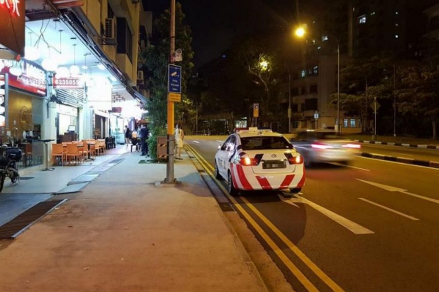 The photo of the police car parked next to a parking enforcement camera was posted on Facebook.