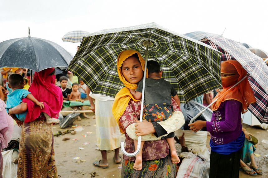 Rohingya refugees in an open area where they are being held by the Border Guard of Bangladesh after illegally crossing the border, in Teknaf, Bangladesh, on Thursday.