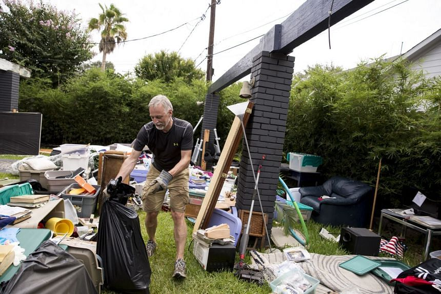 Alan Ruter helps clean out a friend's home in Houston, Sept 1, 2017.