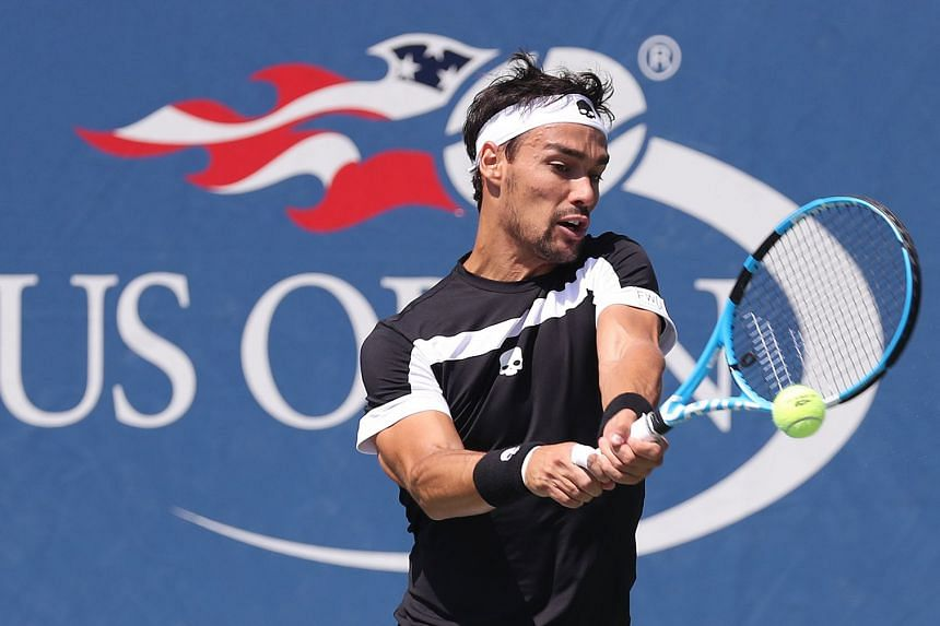 Fognini hits a return to Stefano Travaglia during their match.