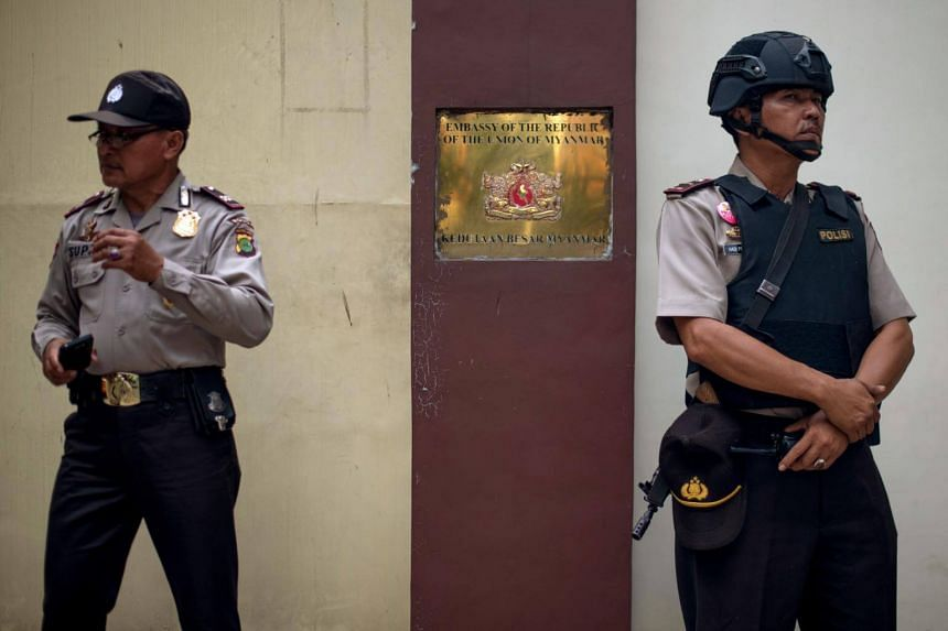 Indonesian police officers standing guard outside the Myanmar embassy in Jakarta on Sept 2, 2017.