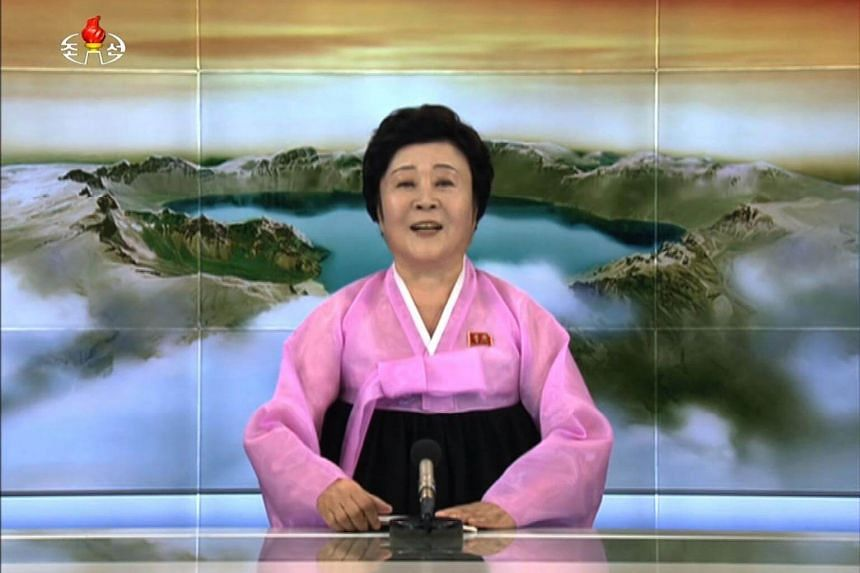 A screengrab showing top North Korean newsreader Ri Chun Hee announcing the successful test of a hydrogen bomb, during a news programme on Sept 3, 2017.