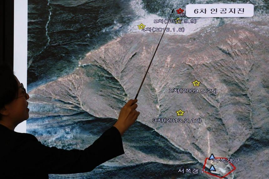 Mr Lee Mi Seon, the director-general of the Earthquake and Volcano Centre of South Korea's Meteorological Administration, pointing out the location of seismic activity in North Korea on Sept 3, 2017.
